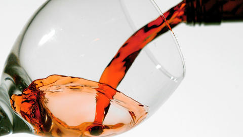 Red wine pouring into glass low angle view Live Action