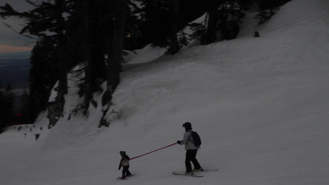 mother skier guides her child skiing Footage