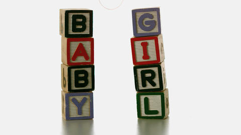 Yellow soother falling besides baby blocks Stock Video Footage