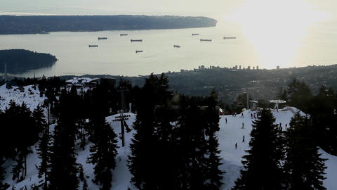 aerial of skiers at grouse - vancouver backdrop Footage