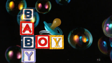 Bubbles moving over baby blocks and blue smoother Stock Video Footage