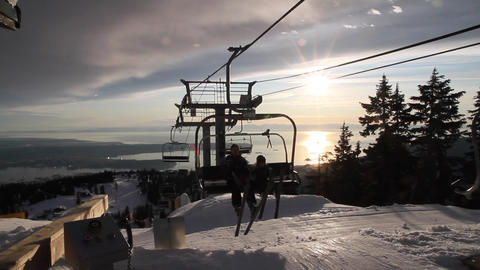 skiers arrive on chairlift - vancouver backdrop Footage
