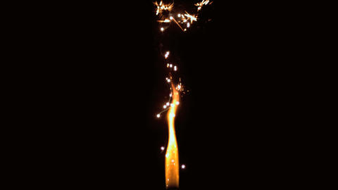 Flame with sparks flying on black background Stock Video Footage