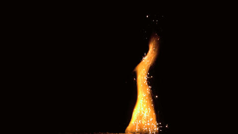 Large flame with sparks on black background Stock Video Footage