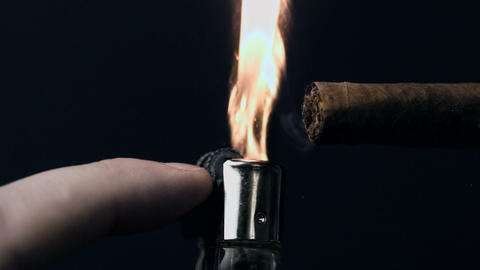 Hand lighting a cigar Stock Video Footage