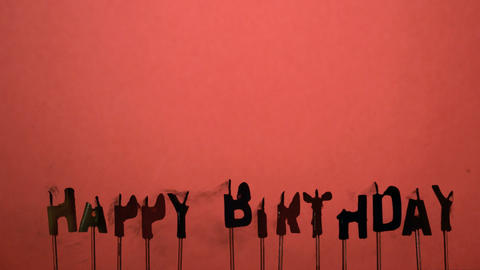 Silhouette of happy birthday candles being extingu Footage