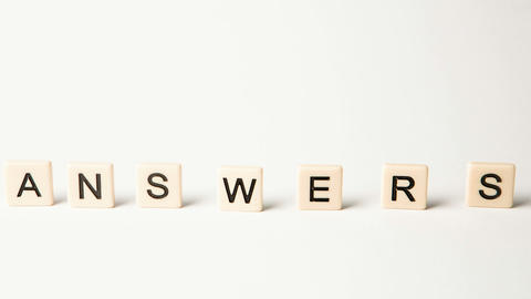 Letter pieces spelling answers and questions stand Stock Video Footage