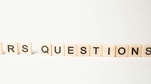 Letter pieces spelling answers and questions standing up... Stock Video Footage