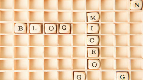 Micro blogging in a crossword shape dispersing Stock Video Footage