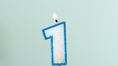 One birthday candle flickering and extinguishing o Stock Video Footage