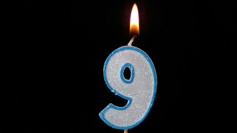 Nine birthday candle flickering and extinguishing Stock Video Footage