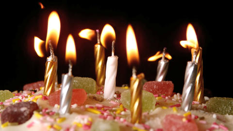 Birthday candles being blown out on a delicious cake... Stock Video Footage
