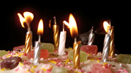 Birthday candles being blown out on a delicious ca Footage