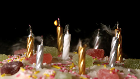 Birthday candles being blown out on a delicious ca Stock Video Footage