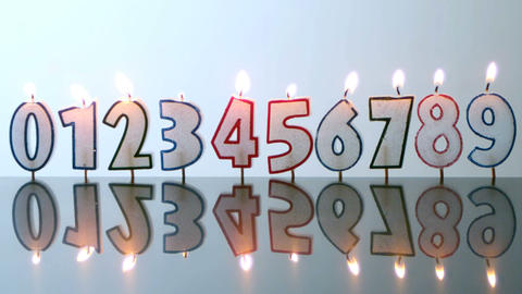 Number candles blowing out in numerical order Stock Video Footage