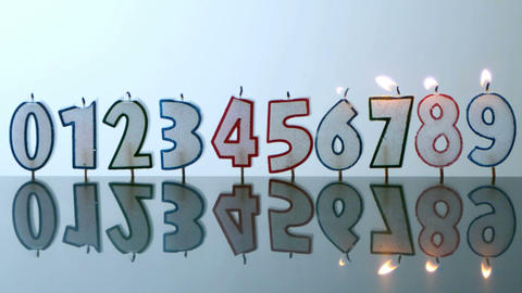 Number candles blowing out in numerical order Footage