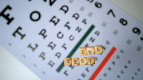 Dice spelling out eye test falling onto eye test b Footage