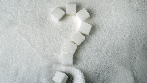 Question mark spelled out in sugar cubes forming o Footage