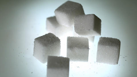 Sugar cube falling onto pile of cubes Footage