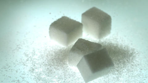 Sugar cube falling onto pile of cubes and powder s Stock Video Footage