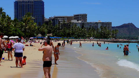 people hanging out at the waikiki beach - diamong Stock Video Footage