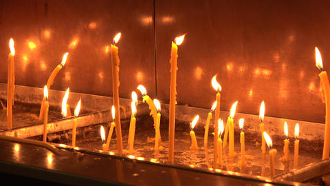 Candles in the Orthodox Church. 4K Stock Video Footage