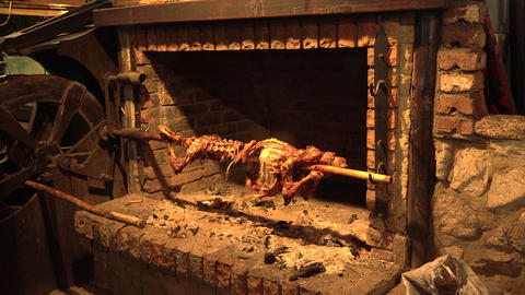 Skeleton pig on a spit. 4K Footage