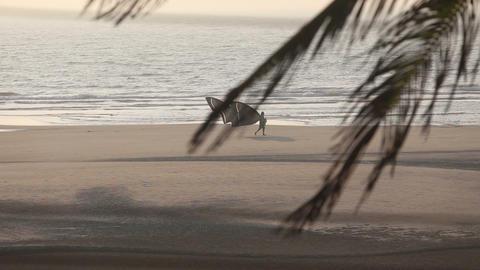 athlete walks along the beach Footage