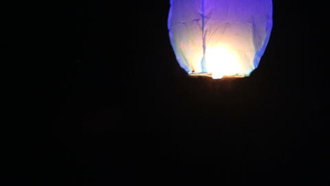 Bride And Groom Lit A Chinese Lantern On The Beach stock footage