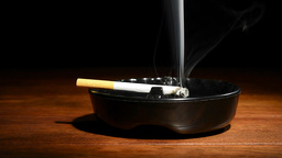 Cigarette In Ashtray stock footage