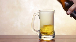 Pouring beer in mug Stock Video Footage