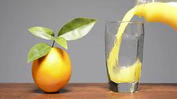 Pouring orange juice Footage