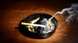 Cigarette in ashtray Stock Video Footage