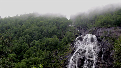 Waterfalls in a foggy mountain Footage