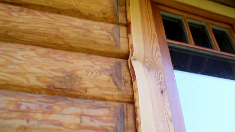 Cabin log house wall and its wooden glass window Live Action