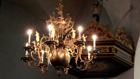 Elegant Lighted Chandelier Hanging In Church stock footage