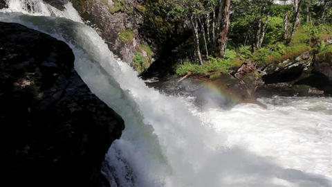 Waterfalls with a strong current making water spra Footage