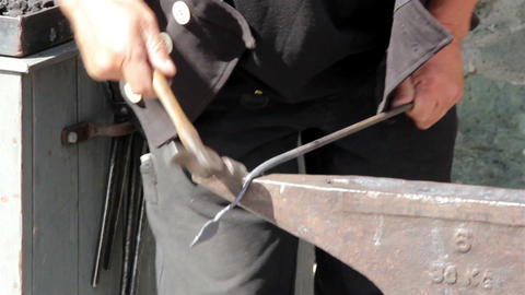 A blacksmith bending hammering of a metal or steel Stock Video Footage