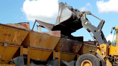Bulldozer adding gravel to gravel bucket filtering Footage