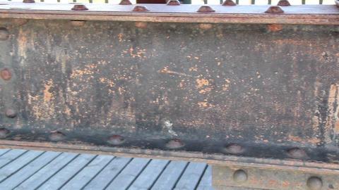Steel beam on wooden bridge rusty rectangular meta Footage