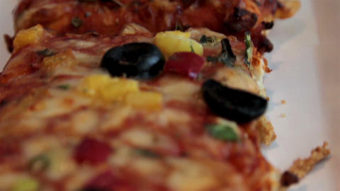 Yummy Long Pizza Layed Out On The Table stock footage