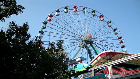 Ferris wheel and other more fun rides moving Stock Video Footage
