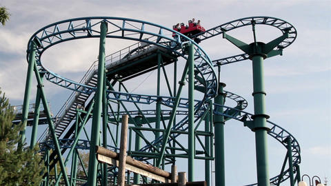 400 Red roller coaster moving upwards afternoon Footage