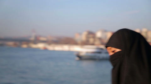 Woman dressed with black headscarf, chador on ista Footage