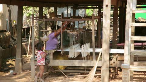 SILK ISLAND, CAMBODIA - MARCH 2014: woman silk man Stock Video Footage