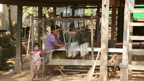 SILK ISLAND, CAMBODIA - MARCH 2014: woman silk man Stock Video Footage