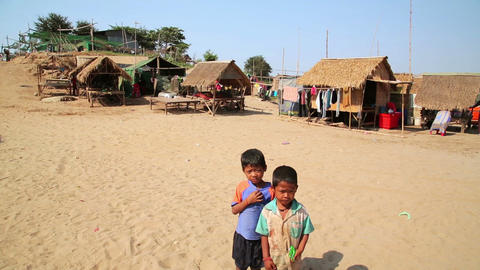 SILK ISLAND, CAMBODIA - MARCH 2014: local kids pos Footage