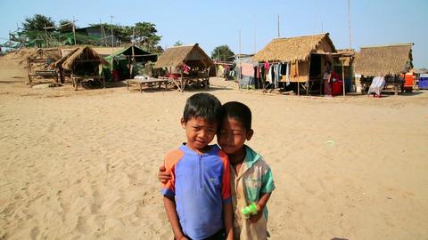 SILK ISLAND, CAMBODIA - MARCH 2014: local kids pos Footage