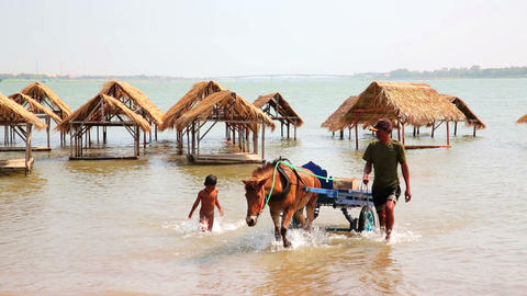 SILK ISLAND, CAMBODIA - MARCH 2014: horse cart tra Footage