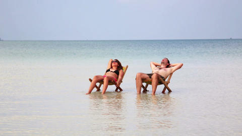 Romantic couple sunbathing inside fantastic crysta Stock Video Footage